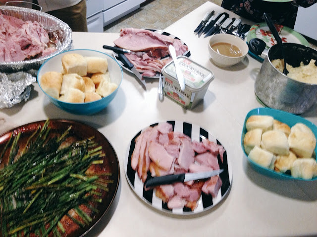 College students' first time ever preparing a holiday dinner. Ham, mashed potatoes, gravy, asparagus, butter rolls! Yum!