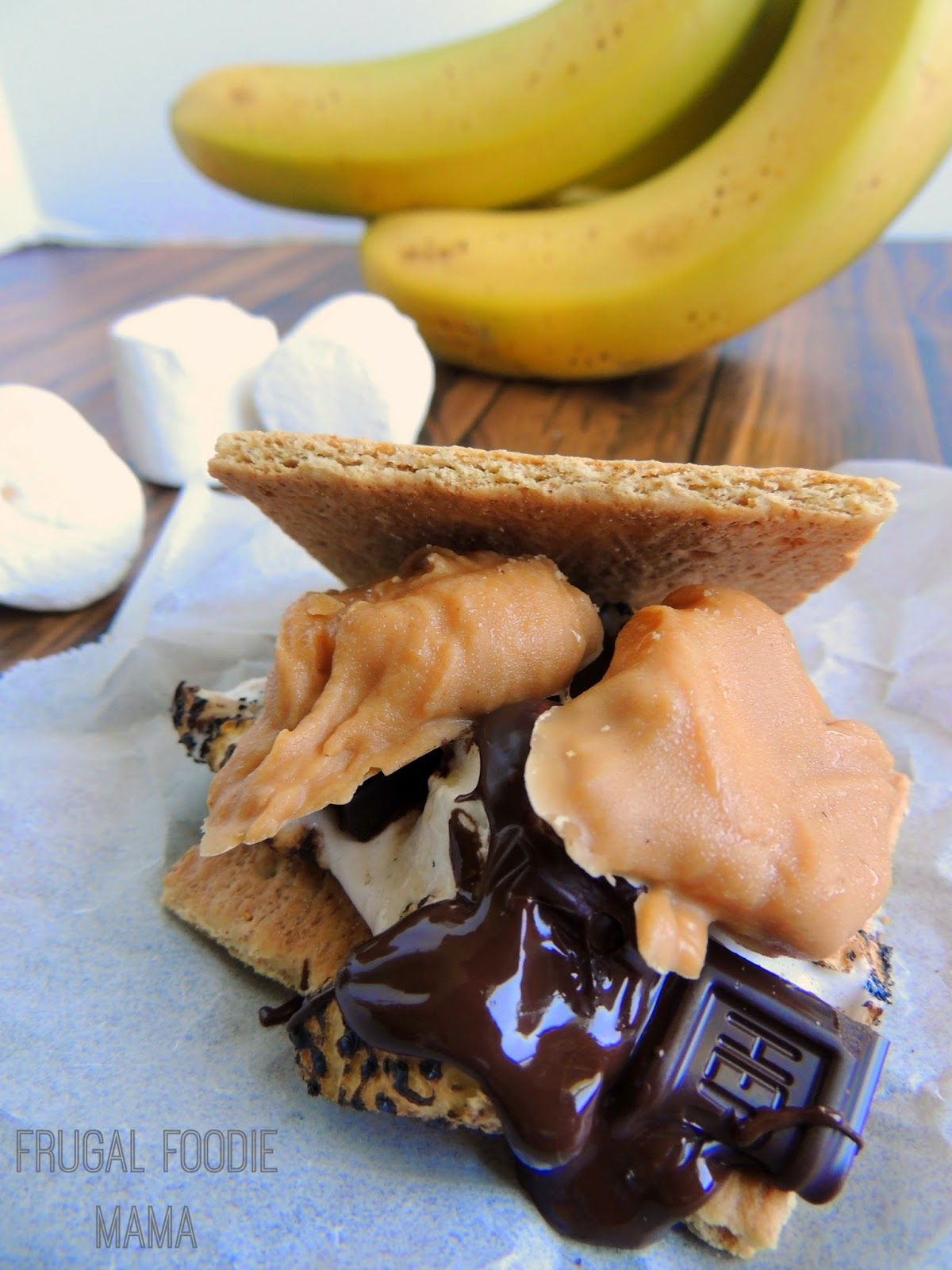 When you add a little fluffernutter action to classic s'mores by adding some peanut butter coated banana slices, you get something truly and deliciously amazing- Fluffernutter Banana S'mores.