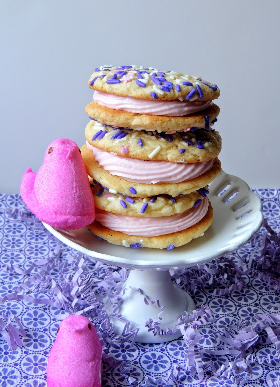 White Chocolate Peeps Cookiewiches- a Peeps marshmallow buttercream is sandwiched between two white chocolate pudding cookies- a perfect sweet treat for Easter or spring!