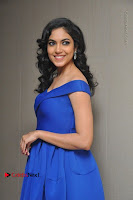 Actress Ritu Varma Pos in Blue Short Dress at Keshava Telugu Movie Audio Launch .COM 0033.jpg