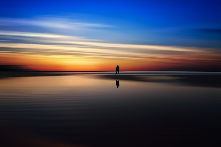 Silhouette of Man on Water