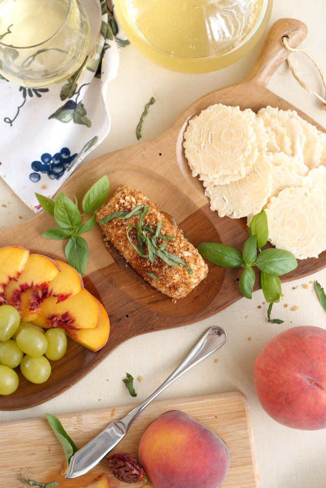 Honey, Basil, and Black Pepper Goat Cheese Spread is an easy to make, yet elegant appetizer made with fresh goat cheese that is rolled in pepper and panko then topped with a generous drizzle of honey and fresh basil.  It all comes together in just minutes! #BuzznBloom #sponsored @BuzznBloom