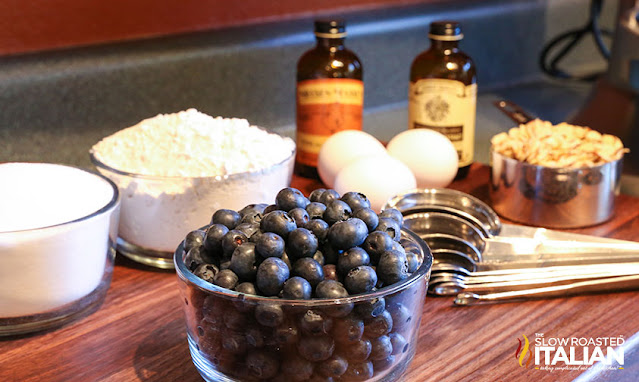 ingredients in glass bowls and measuring cups to make a butter cake recipe