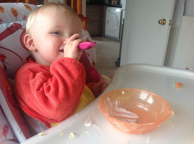 Baby-led-weaning-baby-in-highchair-with-spoon