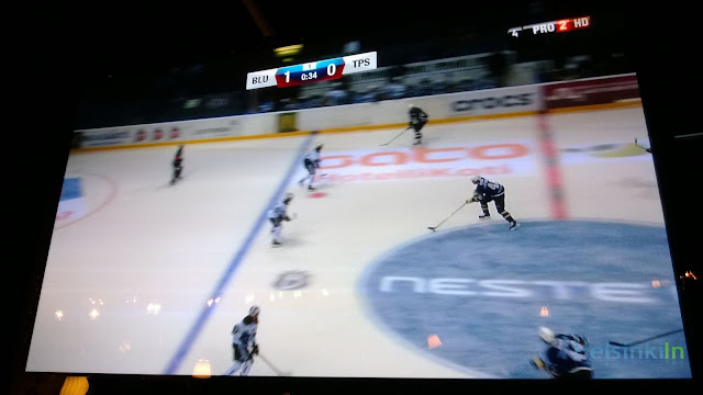 SM Liiga match shown at a bar