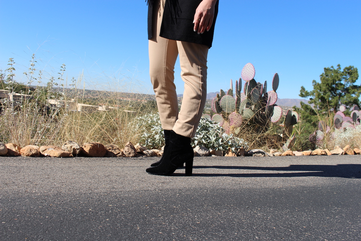 This is a close-up of my black velvet ankle boots, with the caramel jeans, and the desert in the background.