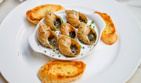 Escargots in generous garlic and butter.