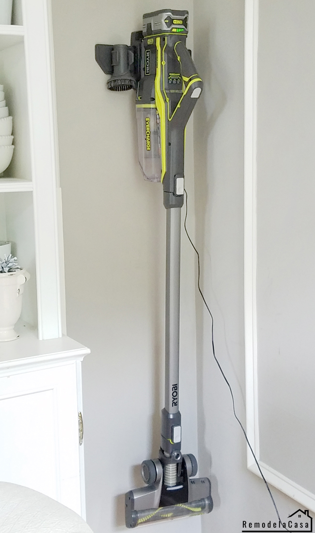 Ryobi stick vacuum cleaner on charging dock on the wall