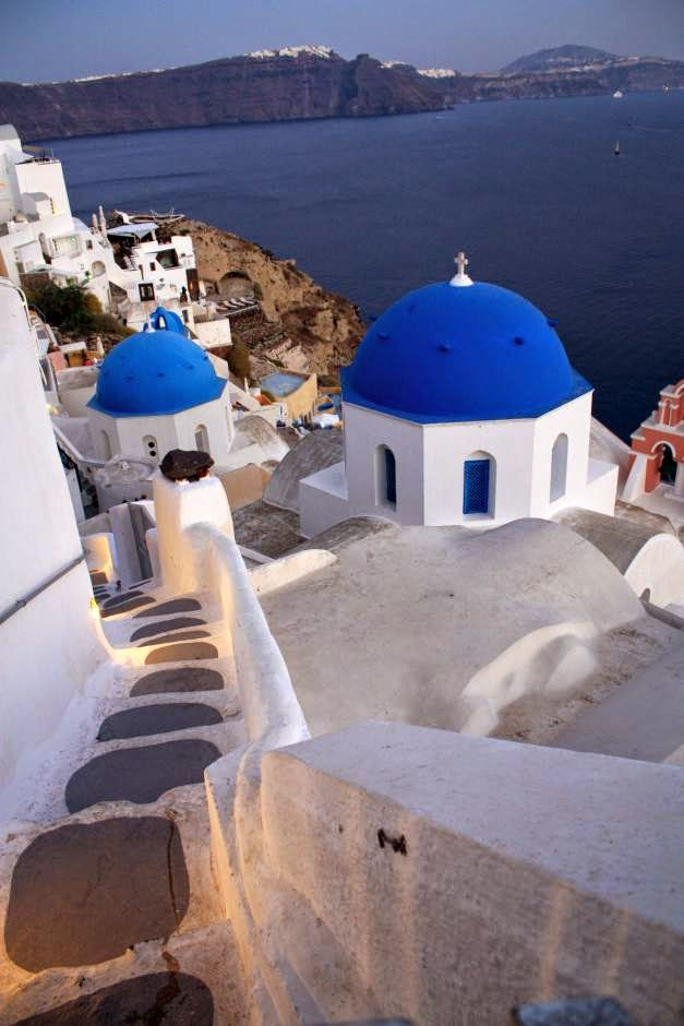 Greek churches with their blue domes in Oia