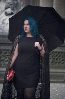 big fashionista in black cape dress