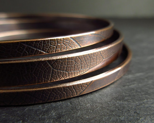 bronze bangles with leaf vein texture