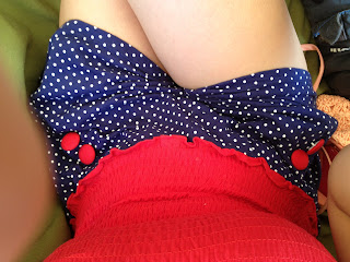 Person wearing a polkadot playsuit