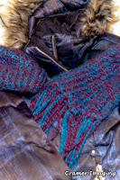 Cramer Imaging's photograph of a winter jacket or coat, a knitted scarf, and a matching knitted hat