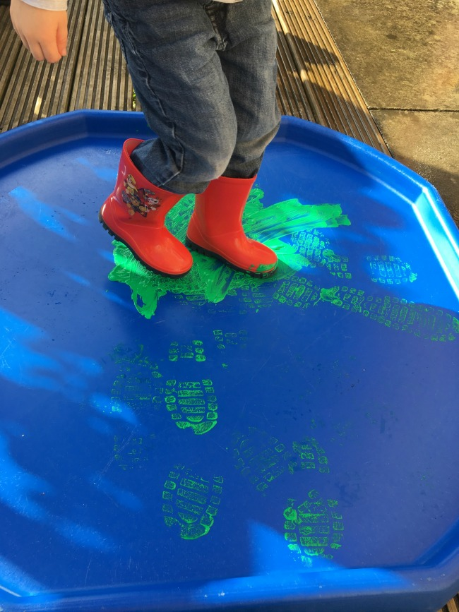 toddler-in-wellies-on-tuff-spot-with-paint