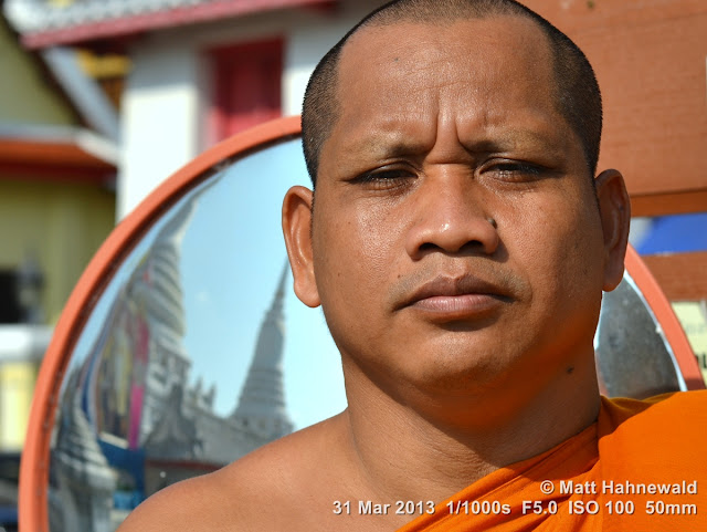 © Matt Hahnewald, Facing the World, people, portrait, street portrait, Thailand, Buddhism, Buddhist monk, orange robe, shaved head, saffron robe, Theravada Buddhism, bhikkhu, temple, wat, Bangkok, religion, culture, face, eye contact