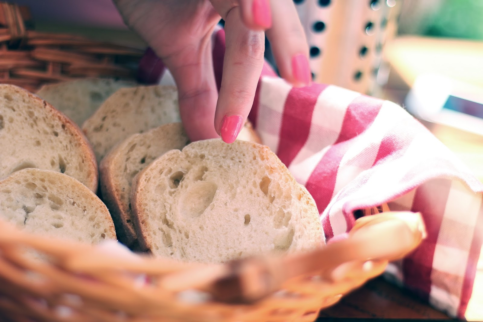Woman arranging bread in a bread basket