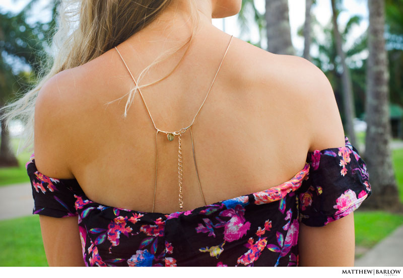 summer outfit idea rose print off shoulder top back chain