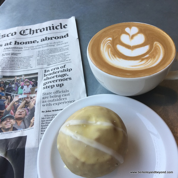 creamsicle vegan donut and cappuccino at Coffee Conscious in Berkeley, California