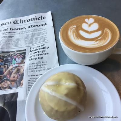creamsicle vegan donut and cappuccino at Coffee Conscious in Berkeley, California