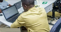 corper with laptop