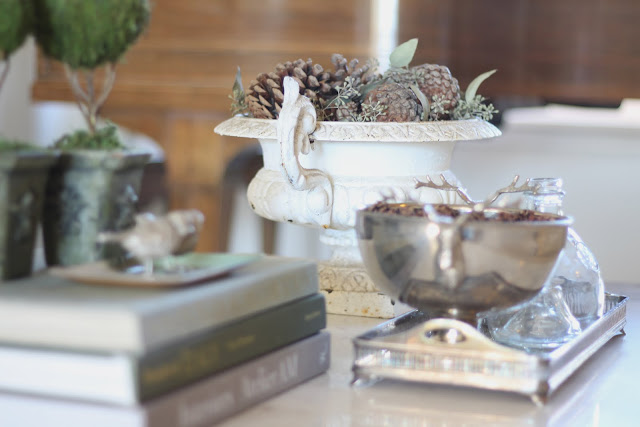 styling a coffee table fall christmas topiaries pinecones