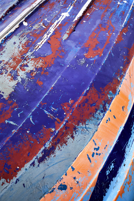 worn paint on old boat at Holy Island, Northumberland by Martyn Ferry Photography