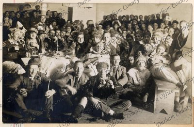 D/DLI 7/424/3(32) 'Here is the photo, taken after [the theatrical] dinner. I [Captain PHB Lyon] am completely invisible, except for one ear and one eyebrow, on the floor at the back', Graudenz, Germany, 18 November 1918