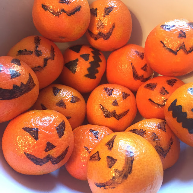 pumpkin satsumas using a Sharpie