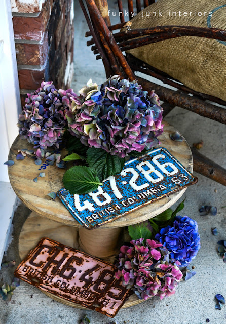 mini spool coffee table with vintage license plates Funky Junk Interiors