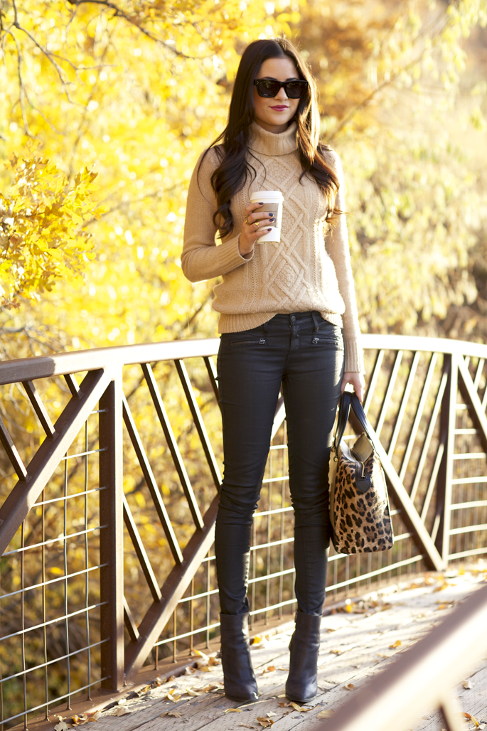 e0001572a95 Rachel from Pink Peonies looks perfectly pulled together in cable turtle  neck sweater, black jeans and leopard print bag.