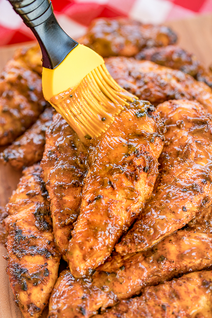 Georgia Gold BBQ Chicken - seriously delicious!!! Grilled chicken basted in a delicious homemade honey mustard bbq sauce. Yellow mustard, dijon mustard, cider vinegar, molasses, honey, butter, worcestershire sauce, garlic powder, black pepper, onion powder, cayenne pepper, oregano and seasoned salt. Can make BBQ sauce ahead of time and refrigerate until ready to cook chicken. This stuff is AMAZING! Perfect for you next cookout!! #grilling #bbqsauce #grilledchicken