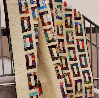 Charm-Square-Strip-Scrap-QuiltFabrication-Quilt