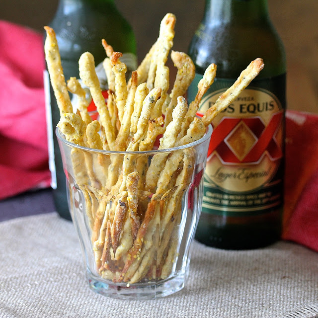 These Crushed Red Pepper Grissini are super spicy, skinny, and crunchy. They are the perfect bar snack, and excellent with a glass of wine or a beer.