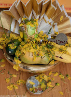 Kerala state flower: Kannikonna  On a Vishu kanni (Vishu greetings  for good luck), with the famous  vallkannadi (special mirror)