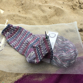 Purple and grey striped hand-knit socks