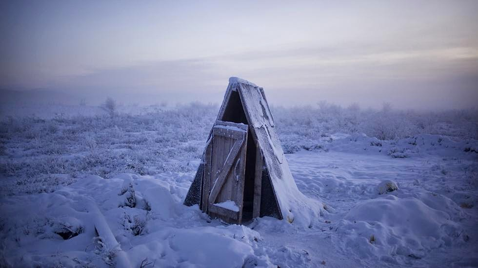 A toilet on the tundra at a petrol stop on the road to Oymyakon. Most toilets in the area are long drops as the constantly frozen soil makes it difficult to dig plumbing. - Welcome to The Coldest Place Inhabited By Humans on Earth
