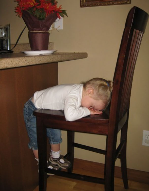 15+ Hilarious Pics That Prove Kids Can Sleep Anywhere - Napping On A Chair