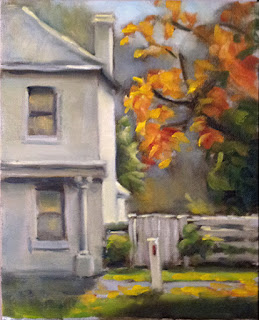 Oil painting of part of a Georgian-style house with a fence and a tree with autumn leaves beside.