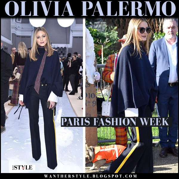 Olivia Palermo in navy cape sweater, navy yellow stripe pants and brown sunglasses what she wore paris fashion week 2017