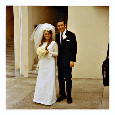 Elena Vasilev and Frank Storti pose outside the Holy Trinity Cathedral in San Francisco, California after their June 1970 wedding.