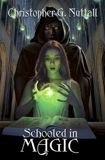 Book cover, 'Schooled in Magic' by Christopher G. Nuttall. Beige-skinned, red-haired woman stands before an open book, gazing with a wondering expression at an orb of green light that is manifesting between the fingers of her hands. A hooded and robed figure stands behind her with a menacing expression on its face.