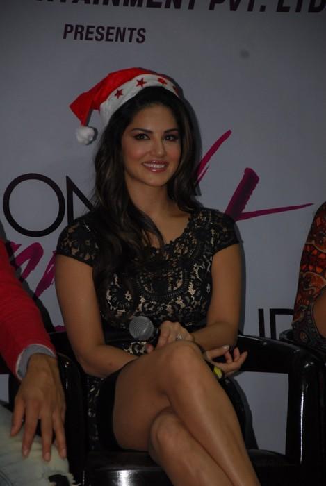 Sunny Leone Long Legs Thighs Stills In Mini Black Skirt