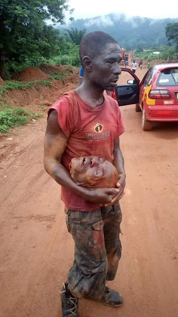 OMG! Man Cuts Off Cousin's Head Because Of Money (GRAPHIC PHOTOS)