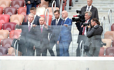 Vladimir Putin with Moscow Mayor Sergei Sobyanin and FIFA President Gianni Infantino.