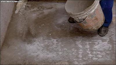 polvilhando cimento queimado