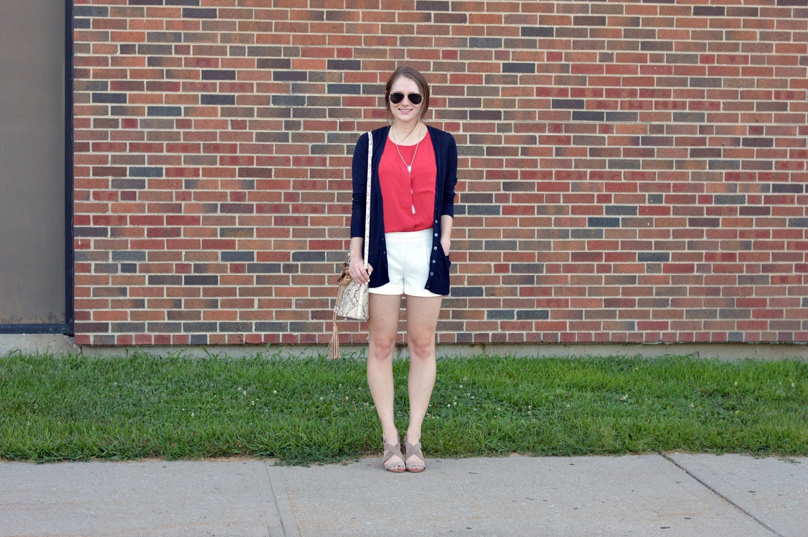 navy sparkle boyfriend cardigan from banana republic on a memory of us | snakeskin tassel bucket bag | what to wear with white shorts | white shorts with a navy cardigan |