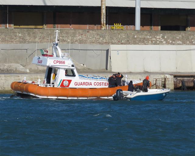 The Coast Guard checking a boat inside the Porto Mediceo, Livorno