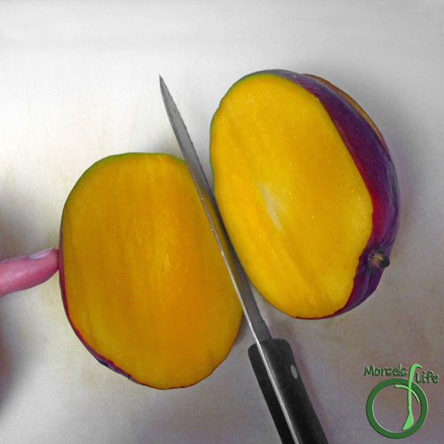 Morsels of Life - How to Cut a Mango Step 1 - Slice through the mango to one side of the seed.