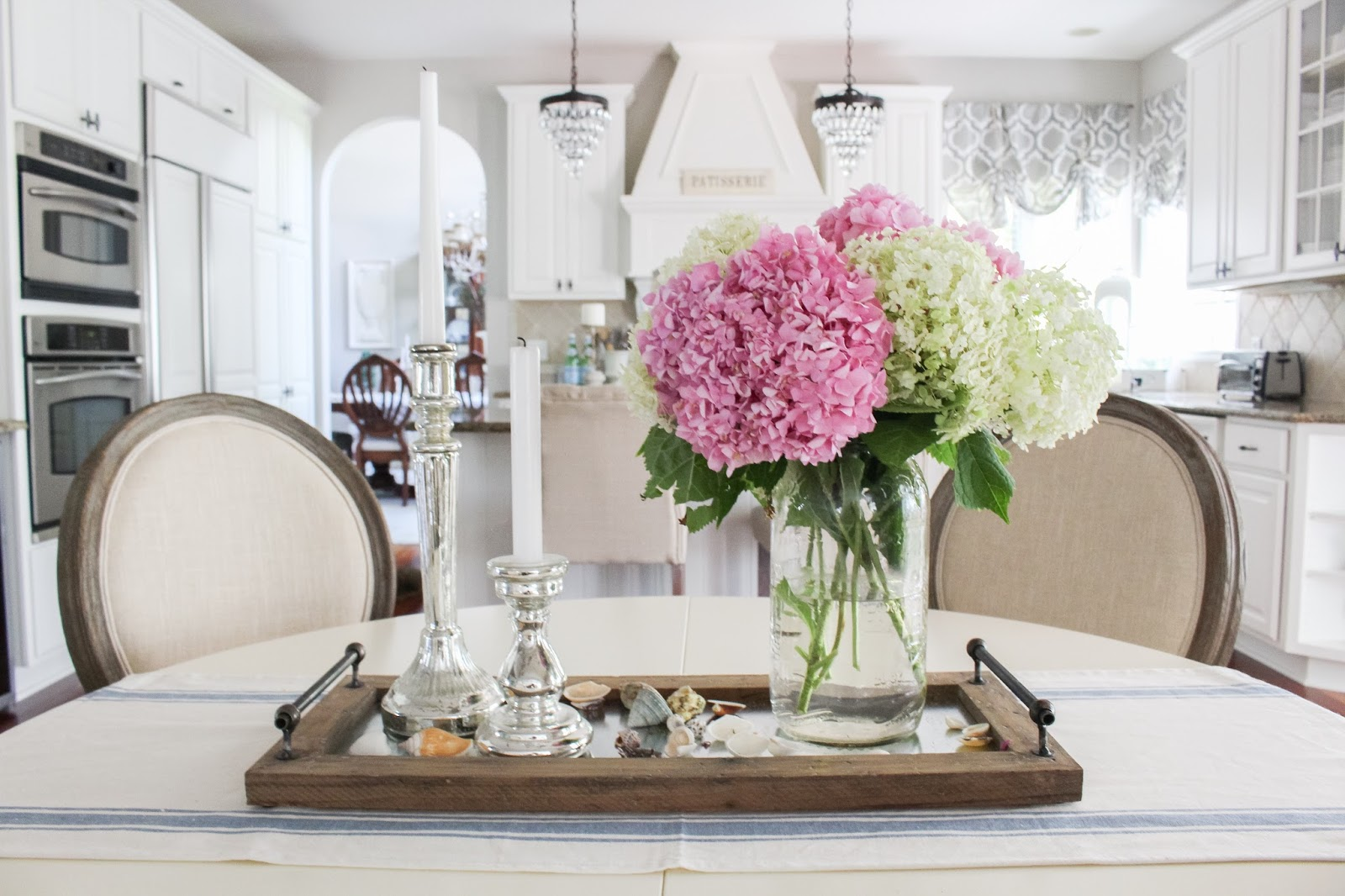 Grouping Several Mason Jars With A Couple Hydrangeas In Each Jar Make For Perfect Summer Centerpiece On Kitchen Island