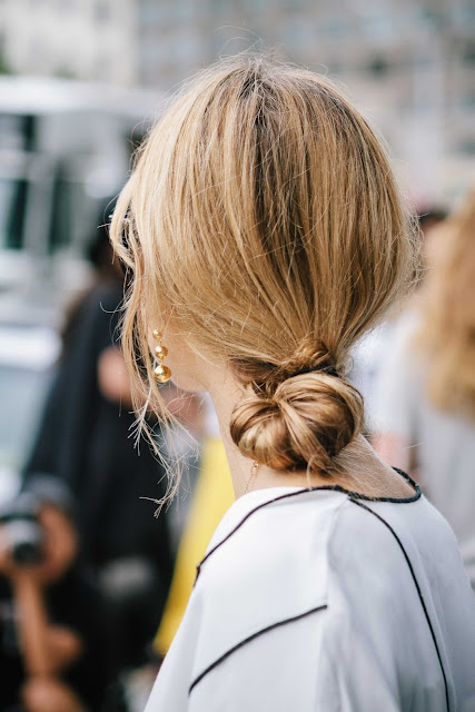 danish blogger Pernille Teisbaek at NYFW with a low loose knot hair style